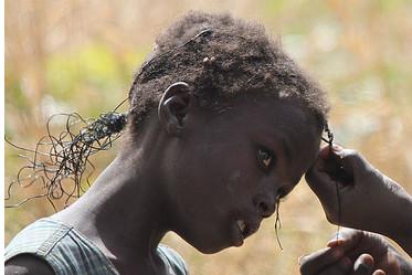 Non aux tresses pour ma fille au Cameroun.